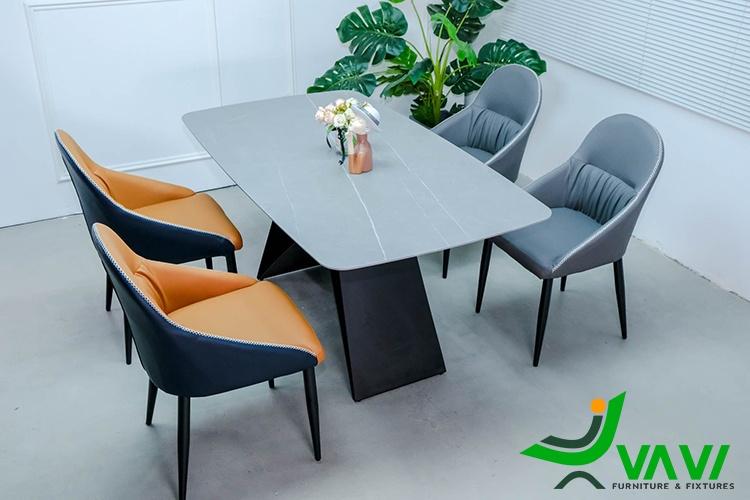Bộ bàn ăn mặt đá 4 ghế hiện đại bọc da chân thép